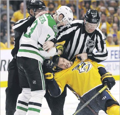 ?? Mark Humphrey/ The Associated Press ?? A pair of Swedes, Stars defenseman John Klingberg (left) and Nashville left wing Viktor Arvidsson, fight during the second period in Wednesday's playoff series opener.