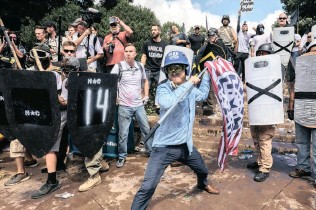 ??  ?? Far-right American protesters incite hatred at a Unite the Right rally in Charlottesville, Virginia. THE WASHINGTON POST PICTURE: EVELYN HOCKSTEIN