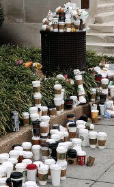 ??  ?? Eyesore: Customers face charges for cups like this pile dumped in street