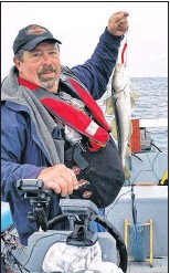?? SUBMITTED PHOTO ?? John Manning fishing in Carbonear on a regular visit back to Newfoundland.