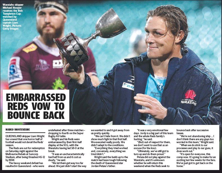 ?? Picture: Getty Images ?? Waratahs skipper Michael Hooper receives the Bob Templeton Cup watched by Queensland captain Liam Wright.