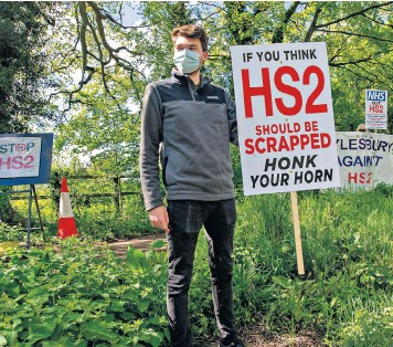 ??  ?? HS2 protester in Aylesbury, Bucks. Those who complain about such schemes, that tear down ancient forests, are dismissed as Nimbys
