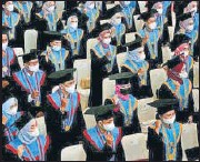 ?? REUTERS ?? Graduates wearing protective masks attend a ceremony at a campus in Makassar, Indonesia.