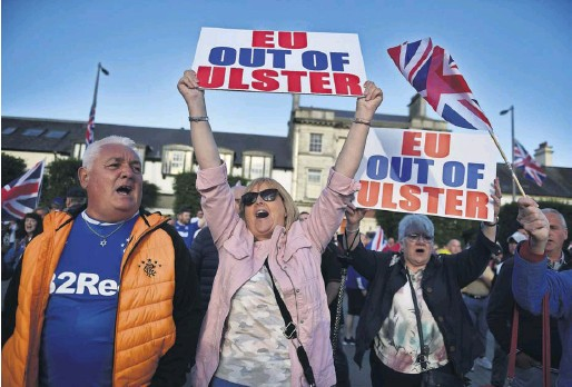 ?? PHOTOGRAPH: CHARLES MCQUILLAN/ GETTY IMAGES ?? Loyalist supporters at an anti-Northern Ireland protocol protest in Newtownards in June
