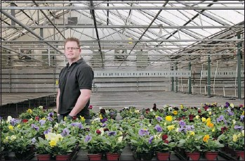 ?? Leah Hennel, Calgary Herald ?? Brad Watson, manager at Sunnyside Home and Garden Centre says the recent snowstorm and continuing cold weather have resulted in the gardening season getting off to a slow start.