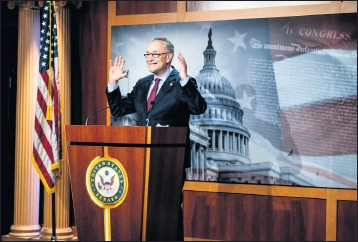 """?? PHOTOS BY ERIN SCHAFF — THE NEW YORK TIMES ?? Senate Majority Leader Chuck Schumer, D-N.Y., voiced optimism Saturday that the relief bill will boost the economy. """"The danger of undershooting is far greater than the danger of overshooting,"""" he said about the $1.9 trillion price tag."""