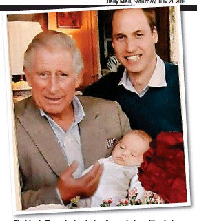 ??  ?? First look: The private photo of grandad cradling baby George, with Wills behind, which sits on Charles's desk