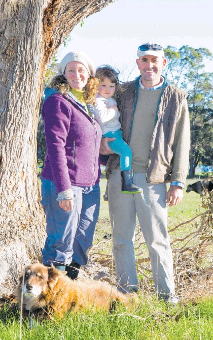 ?? Picture: Warren Hately ?? Laura Bailey and daughter Isabel, 2, and partner Lawson Armstrong, are the faces behind Margaret River Organic Farmer, with the help of Jasper the dog.