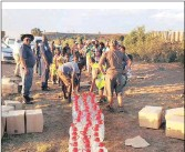 ??  ?? CARING GESTURE: Hundreds of 5-litre and 2-litre containers of bottled water are delivered to drought-stricken farms around Senekel in the Free State by Operation Hydrate.