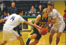 ?? Herald photo by Dale Woodard ?? Chase Harris of the Magrath Zeniths drives past Calgary Crescent Heights Cowboys Aidan Wiong and Dylan Bilinsky in the consolation final at the LCI Green and Gold Basketball Tournament Saturday afternoon at LCI. The Zeniths won the game 92-83.