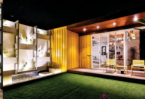 """??  ?? ROOFTOP PARADISE Located in Delhi, this home is constructed using steel panels refurbished from shipping containers. """"For the interiors, bright colour pops have been introduced,"""" says Bhatia. The remaining components are monochrome, only differing in texture and feel. """"Since the small studio has busy interiors the outdoors are highlighted as larger chunks of colour blocks in ochre, white and sap green. Instead of the usual wall creepers, the planters on the wall are designed to fit on a ladder-like structure and can be composed differently as the plantats in them changes,"""" adds Bhatia."""