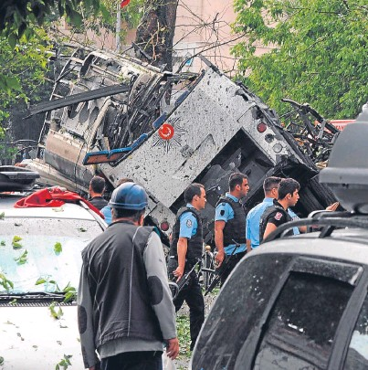 ?? Picture: AP. ?? Turkish security officials and firefighters work at the explosion site.