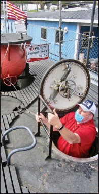 ?? (Special to the Democrat-Gazette/Jack Schnedler) ?? A visitor climbs out of the USS Razorback after touring the World War II submarine.