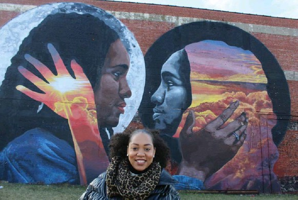 """?? JENNIFER BAIN/TORONTO STAR ?? On an outdoor art crawl of Newark, the city's """"glambassador"""" Lauren Craig shows off one of many murals in the Clinton Ave. corridor where you'll find """"a smorgasbord of art."""""""
