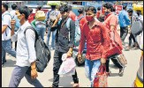 ?? AGENCY ?? Migrant workers arrive in Hyderabad large numbers on Sunday in search for job.