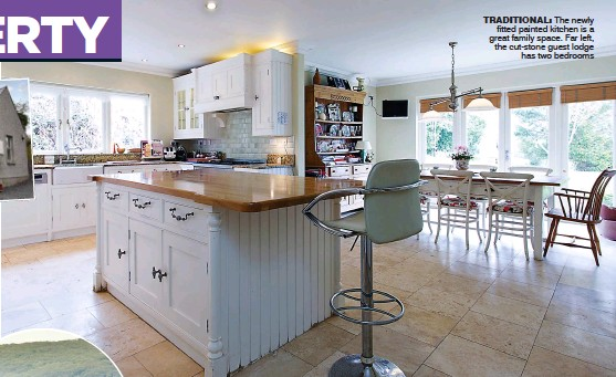 ??  ?? traditional: The newly fitted painted kitchen is a great family space. Far left, the cut-stone guest lodge has two bedrooms