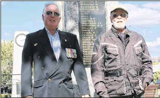 ?? PHOTO: Nathan De Vrees ?? LEST WE FORGET: Myrtleford RSL vice president Trevor Isherwood and Bryan Meehan, pictured at the Lowerson Statue, are looking forward to a successful ANZAC Day.