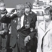 ?? NICOLAS GARRIGA/AP ?? Charles Shay salutes during a D-Day ceremony Friday in Carentan, Normandy. He was the only veteran to attend the ceremony in the small town.