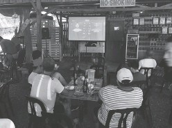 ??  ?? SPORTS enthusiasts anxiously waiting for round one of the Pacquiao-Thurman bout at ReHub resto.