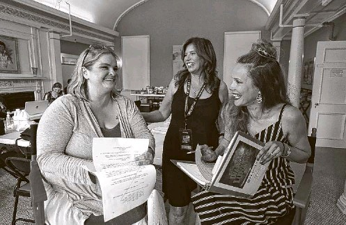 """?? Sharon Cantillon/Buffalo News ?? Discussing the """"Diary of a Lunatic"""" script are, from left, local actor Melody Nardone, Kimberly Eastwood, one of the producers, and actor Tracey B. Wilson."""
