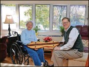 """?? PHOTO CONTRIBUTED BY DAN CURRAN/ATLANTA JOURNAL-CONSTITUTION/TNS ?? Betty Tarr, an independent living resident at Wesley Woods Towers, is shown here chatting with her son Sam about a handmade dulcimer that was a gift from her late husband. She didn't wait for her children to have """"the talk"""" with her about moving from her home in Hartwell, Ga. She knew it was no longer safe for her to live alone."""