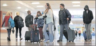 ?? ALEXA WELCH EDLUND/ TIMES-DISPATCH ?? Passenger trafficwas busy Tuesday at RIC and is expected to be again onWednesday.