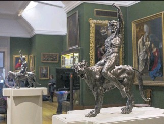 ?? JACK TAYLOR/AFP/GETTY IMAGES ?? The two bronze statues named Bacchants Riding on Panthers, now thought to be by Michelangelo. The 16th-century Italian master is thought to have worked on them between his two most famous works — the marble sculpture David and the ceiling of the...