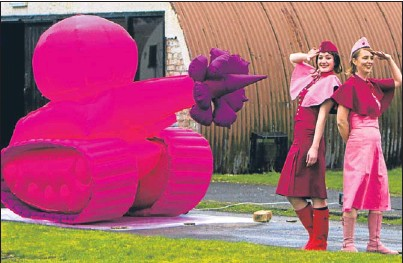 ?? Picture: Steve MacDougall. ?? Hazel Powell, left, and Zoe Walker alongside Zoe Walker and Neil Bromwich's Siege Weapons of Love, Tank — a pink inflatable armoured vehicle with a flower motif protruding from the gun.