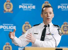 ?? IAN KUCERAK ?? Edmonton Police Service Insp. Mark Neufeld spoke at a news conference Friday, noting there are more 'high-end' guns on the street.