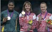 ??  ?? NOT VERY HAPPY: Russia's Mariya Savinova, centre, wins gold, South Africa's Caster Semenya won silver and Russia's Ekaterina Poistogova won bronze in London.