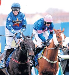 ??  ?? Magic Thunder, left, and Tom Scudamore after crossing the line to win the Scottish National at Ayr.