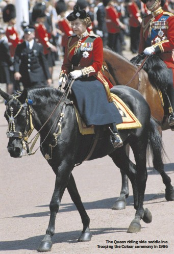 ??  ?? The Queen riding side-saddle in a Trooping the Colour ceremony in 1986