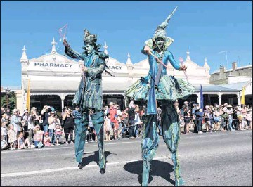 ?? PHOTO: Coral Cooksley ?? PRECIOUS: 'Water droplets,' on stilts made a colourful and meaningful presence in the Golden Horses Shoes Festival Grande Parade on Easter Saturday.