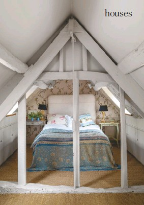 ??  ?? ATTIC BEDROOM Ancient beams frame the guest room tucked into a nook. The upper floors are carpeted in natural seagrass – another way Willow likes to bring the outdoors in. Wallpaper, Nina Campbell. Vintage quilt, Guinevere