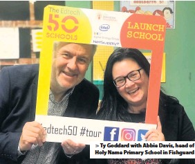 ??  ?? > Ty Goddard with Abbie Davis, head of Holy Name Primary School in Fishguard
