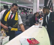 ??  ?? TOP-FLIGHT RUGBY: Wal­la­bies star Sekope Kepu (right) checks in at Syd­ney Air­port, helped by brother Sione.