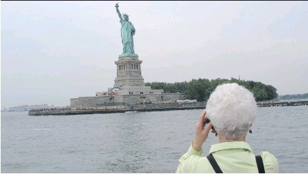 ?? PHOTOS: JIM BYERS ?? The free Staten Island Ferry remains a great way to see some of New York City and get up close to the Statue of Liberty.