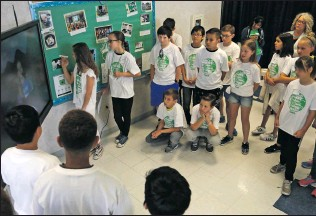 ?? Katharine Lotze/The
