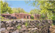 ??  ?? The Turtle Walk estate in Taos Valley includes a pool, small guest/caretaker houses, a courtyard, gardens and a mountain view. The asking price was $2.9 million.