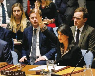 ?? (Brendan McDermid/Reuters) ?? US AMBASSADOR to the United Nations Nikki Haley vetoes an Egyptian-drafted resolution regarding recent decisions about the status of Jerusalem, during a UN Security Council meeting yesterday in New York.