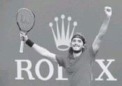 ?? ALEXANDER HASSENSTEI­N Getty Images ?? Stefanos Tsitsipas celebrates after beating Andrey Rublev to win the Rolex Monte-Carlo Masters on Sunday.