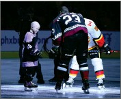?? AP PHOTO BY ROSS D. FRANKLIN ?? Leighton Accardo, left, who is battling cancer, drops the puck in front of Arizona Coyotes' Oliver Ekman-larsson (23) and Calgary Flames' Mark Giordano (5) during an NHL Fights Cancer puck drop ceremony prior to an NHL hockey game in Glendale, Ariz., in this Saturday, Nov. 16, 2019, photo.