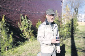 ?? JAMES H. WALLACE/ TIMES-DISPATCH ?? Frank Pichel is selling little pine trees harvested fromhis Nelson County land to benefit Anna Julia Cooper Episcopal School in Richmond's East End.