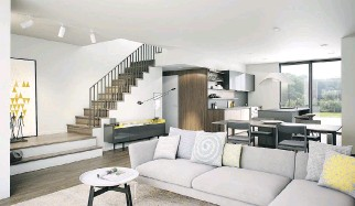 ??  ?? Townhouse interiors feature open spaces and abundant light. Its kitchens, too, offer a clean, minimalist design.