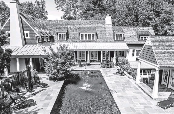 ?? HOMEVISIT PHOTOS ?? The four-bedroom house in the Merry-Go-Round Farm community in Potomac, Md., includes a pool and a flagstone wraparound porch.