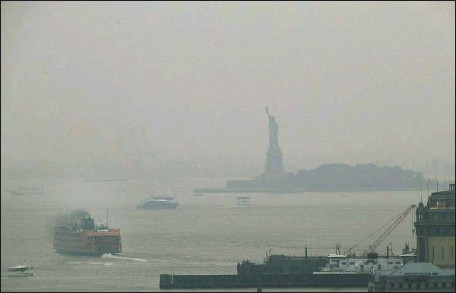 ?? Julie Jacobson Associated Press ?? THE STATUE of Liberty is barely visible Tuesday as smoke from wildfires in the Western United States blankets New York in haze.
