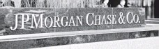 ?? STAN HONDA, AFP/GETTY IMAGES ?? JP Morgan Chase is one of 10 institutions unbound by the deal.