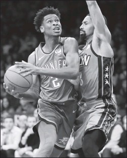 ?? Associated Press photo ?? Brooklyn Nets guard Spencer Dinwiddie (8) defends as Oklahoma City Thunder guard Shai Gilgeous-Alexander looks for his opening during an NBA basketball game last week in New York.