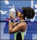 ?? Seth Wenig / Associated Press ?? Naomi Osaka celebrates after defeating Victoria Azarenka for the 2020 U.S. Open crown.