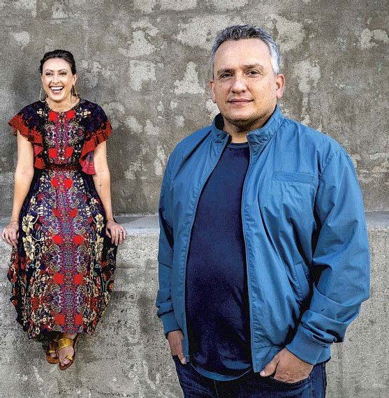 """?? Mel Melcon Los Angeles Times ?? ANGELA Russo-Otstot, who cowrote """"Cherry,"""" is f lanked by her brothers Anthony Russo, left, and Joe. Their family is not unfamiliar with the problems associated with the opioid epidemic."""